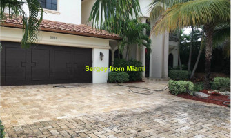 Pressure washing of the pool deck, patio deck, driveway, and sidewalk at Blue Water Terrace N, Pompano Beach, FL 33062
