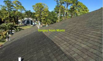 Pressure washing of the roof, gutters, sidewalk, and driveway at 78th Pl N, Loxahatchee, Florida 33470